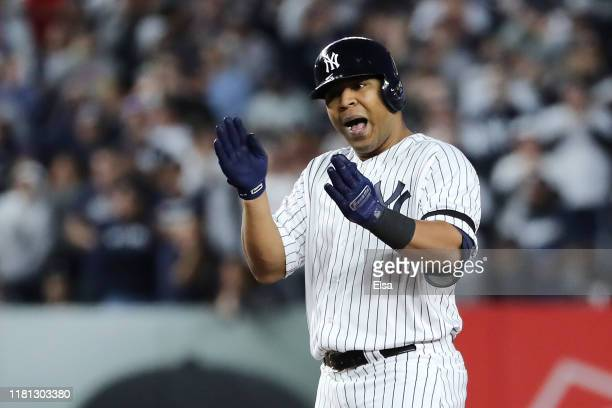 Edwin Encarnacion of the New York Yankees celebrates hitting a double during the fifth inning against the Houston Astros in game three of the...
