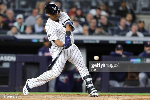 Edwin Encarnacion of the New York Yankees hits a double to left field to score DJ LeMahieu against Jose Berrios of the Minnesota Twins during the...