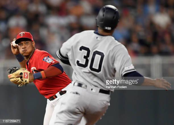 Edwin Encarnacion of the New York Yankees is out at second base as Jorge Polanco of the Minnesota Twins attempts to turn a double play during the...