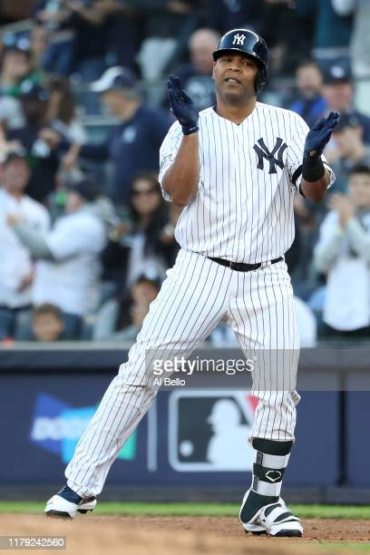 Edwin Encarnacion of the New York Yankees reacts after his RBI single off Randy Dobnak of the Minnesota Twins in the first inning of game two of the...
