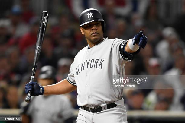 Edwin Encarnacion of the New York Yankees reacts to a check swing in game three of the American League Division Series against the Minnesota Twins at...