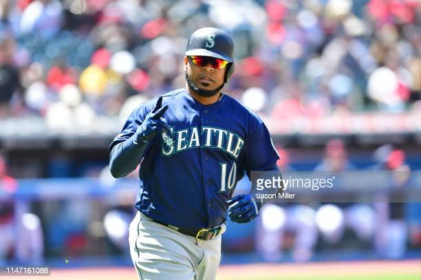 Edwin Encarnacion of the Seattle Mariners celebrates as he rounds the bases after hitting a two run homer during the fourth inning against the...