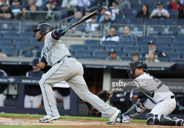 Edwin Encarnacion of the Seattle Mariners drives a run in with a sacrifice fly in the first inning against the New York Yankees during their game at...