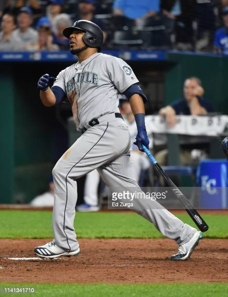 Edwin Encarnacion of the Seattle Mariners hits a threerun home run in the sixth inning against the Kansas City Royals at Kauffman Stadium on April 08...