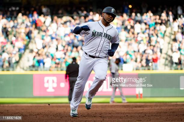 Edwin Encarnacion of the Seattle Mariners rounds the bases after hitting a home run during the third inning of the 2019 Opening day game against the...
