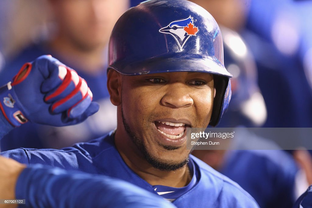 Edwin Encarnacion #10 of the Toronto Blue Jays celebrates as he in the dugout after hitting a two run home run in the ninth inning against the Los Angeles Angels of Anaheim at Angel Stadium of Anaheim on September 16, 2016 in Anaheim, California.