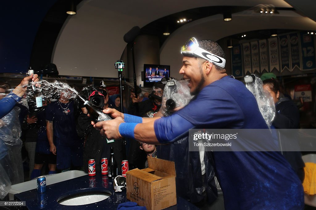 Edwin Encarnacion #10 of the Toronto Blue Jays celebrates in the clubhouse after hitting a three-run walk-off home run in the eleventh inning to defeat the Baltimore Orioles 5-2 in the American League Wild Card game at Rogers Centre on October 4, 2016 in Toronto, Canada.