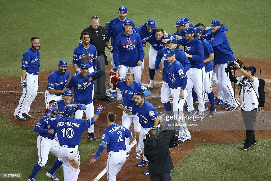 Edwin Encarnacion #10 of the Toronto Blue Jays celebrates with teammates after hitting a three-run walk-off home run in the eleventh inning to defeat the Baltimore Orioles 5-2 in the American League Wild Card game at Rogers Centre on October 4, 2016 in Toronto, Canada.