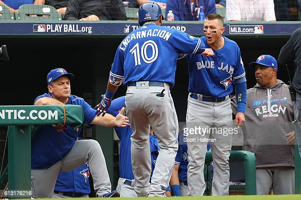 Edwin Encarnacion of the Toronto Blue Jays celebrates with Troy Tulowitzki after hitting a solo home run against the Texas Rangers in the fifth...