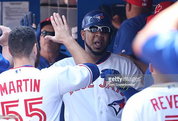 Edwin Encarnacion of the Toronto Blue Jays is congratulated by Russell Martin after hitting a solo home run in the first inning during MLB game...