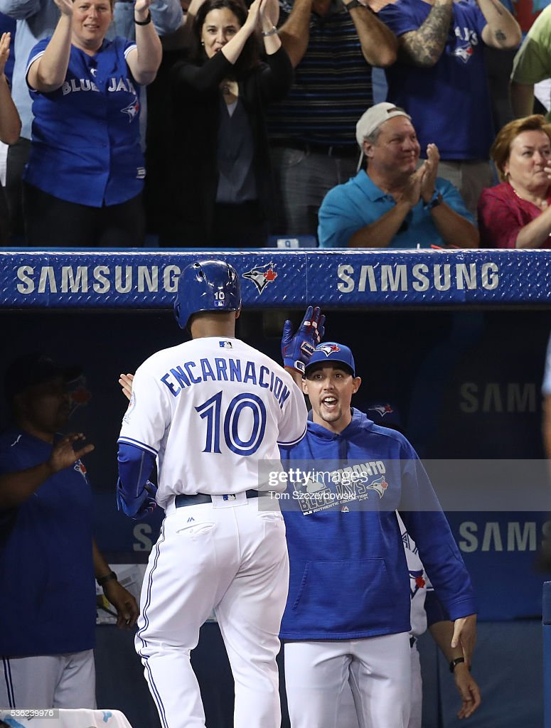Edwin Encarnacion #10 of the Toronto Blue Jays is congratulated by Aaron Sanchez #41 after scoring a run in the seventh inning during MLB game action against the New York Yankees on May 31, 2016 at Rogers Centre in Toronto, Ontario, Canada.