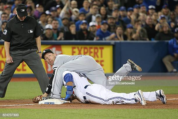 Edwin Encarnacion of the Toronto Blue Jays is tagged out at third base by Todd Frazier of the Chicago White Sox as he tries to advance on a single...