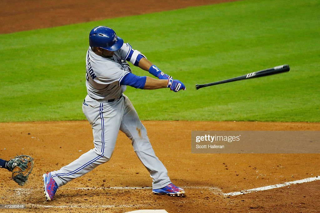 Edwin Encarnacion #10 of the Toronto Blue Jays loses hold of his bat in the sixth inning of their game against the Houston Astros at Minute Maid Park on May 14, 2015 in Houston, Texas.