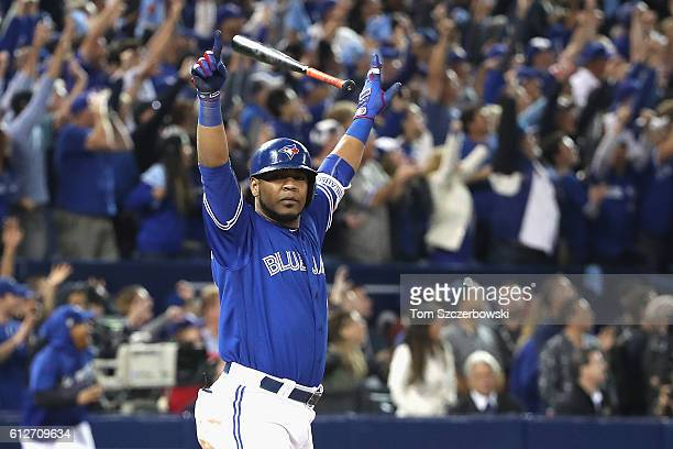 Edwin Encarnacion of the Toronto Blue Jays reacts after hitting a three-run walk-off home run in the eleventh inning to defeat the Baltimore Orioles...