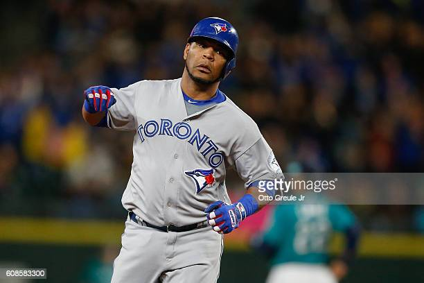Edwin Encarnacion of the Toronto Blue Jays rounds the bases after hitting a tworun home run against the Seattle Mariners in the third inning at...