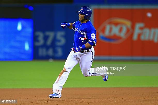Edwin Encarnacion of the Toronto Blue Jays runs the bases after hitting a threerun walkoff home run in the eleventh inning to defeat the Baltimore...