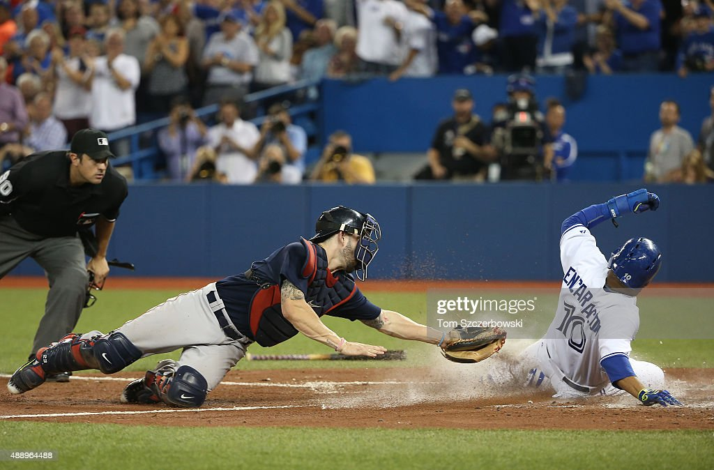 Edwin Encarnacion #10 of the Toronto Blue Jays slides into home plate to score a run in the fourth inning during MLB game action as Blake Swihart #23 of the Boston Red Sox reaches with an attempted tag on September 18, 2015 at Rogers Centre in Toronto, Ontario, Canada.