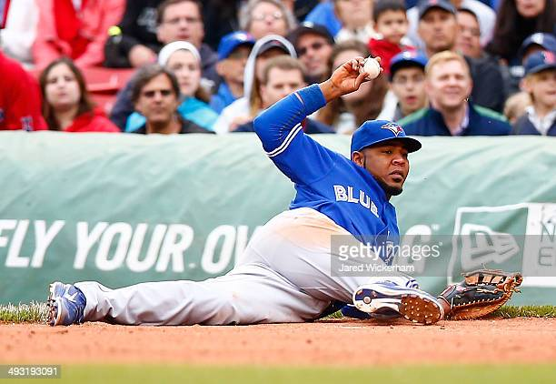 Edwin Encarnacion of the Toronto Blue Jays throws to first base from the ground against the Boston Red Sox during the game at Fenway Park on May 22...