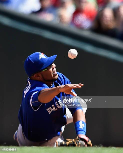 Edwin Encarnacion of the Toronto Blue Jays throws to get out Joe Mauer of the Minnesota Twins at first base during the sixth inning of the game on...