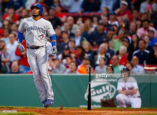 Edwin Encarnacion of the Toronto Blue Jays watches the ball after hitting a tworun home run in the third inning against the Boston Red Sox during the...