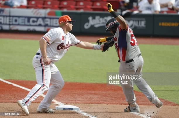 Edwin Espinal Aguilas Cibaenas of Republica Dominicana is taggede out at second base by Balbino Fuenmayor Caribes de Anzoategui of Venezuela during...