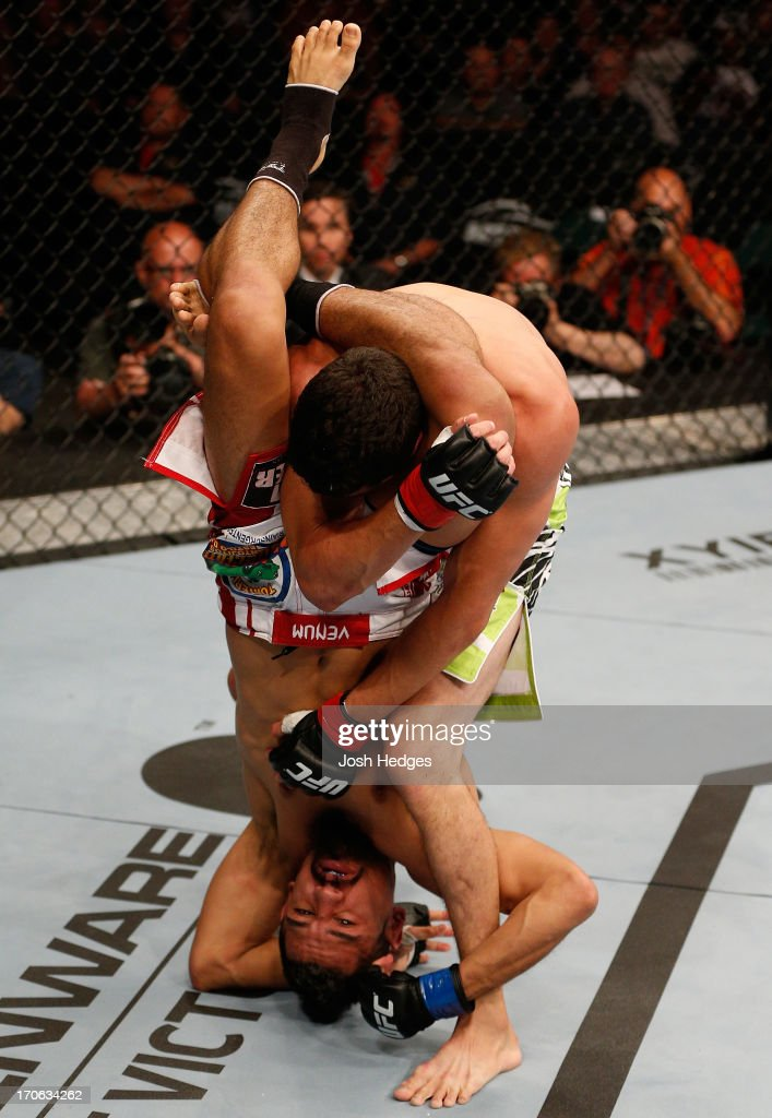 Edwin Figueroa (bottom) attempts to secure a triangle choke submission against Roland Delorme in their bantamweight fight during the UFC 161 event at the MTS Centre on June 15, 2013 in Winnipeg, Manitoba, Canada.