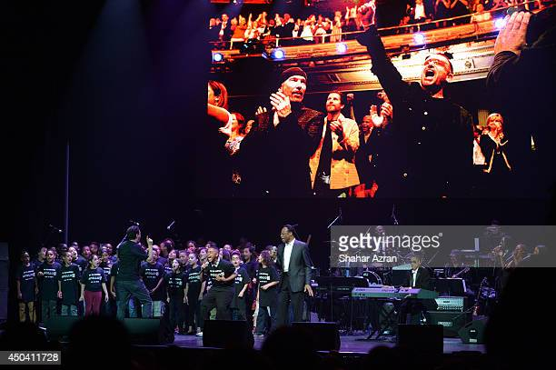 Edwin Hawkins and PS 22 perform on stage during the Apollo Spring Gala and 80th Anniversary Celebration at The Apollo Theater on June 10 2014 in New...