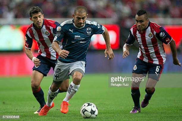 Edwin Hernandez and Carlos Cisneros of Chivas fight for the ball with Walter Gargano of Monterrey during the 2nd round match between Chivas and...
