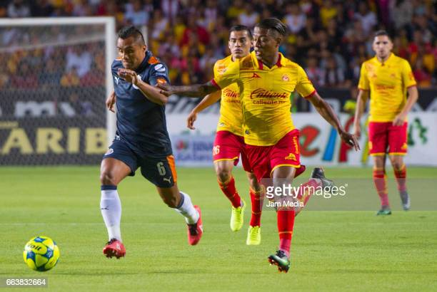 Edwin Hernandez of Chivas and Andy Polo of Morelia fight for the ball during the 12th round match between Morelia and Guadalajara as part of the...