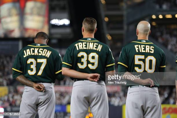 Edwin Jackson Blake Treinen and Mike Fiers of the Oakland Athletics line up for the national anthem the American League Wild Card game against the...
