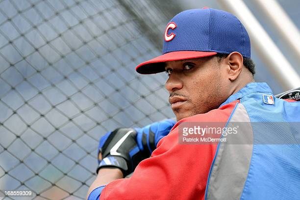 Edwin Jackson of the Chicago Cubs watches batting practice before a game against the Washington Nationals at Nationals Park on May 11 2013 in...