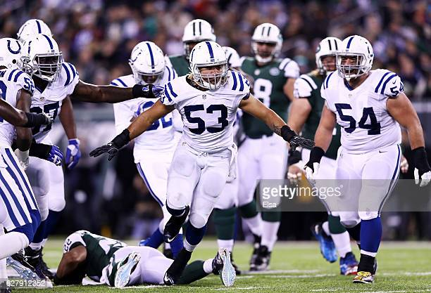 Edwin Jackson of the Indianapolis Colts celebrates after stopping Matt Forte of the New York Jets in the second quarter during their game at MetLife...