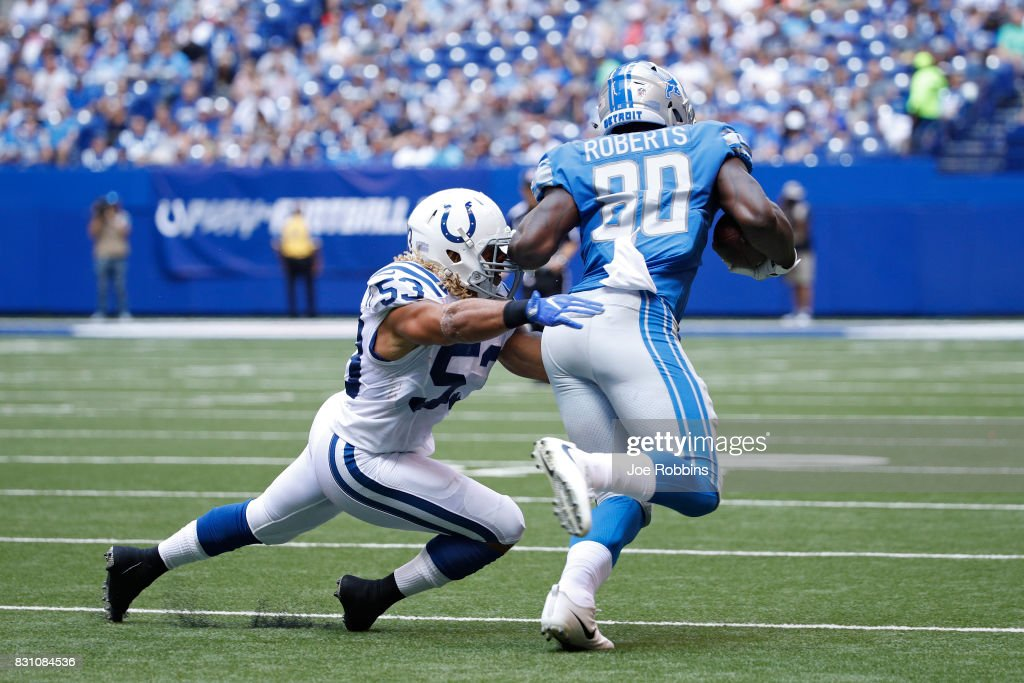 Edwin Jackson #53 of the Indianapolis Colts makes a tackle against Michael Roberts #80 of the Detroit Lions in the first half of a preseason game at Lucas Oil Stadium on August 13, 2017 in Indianapolis, Indiana.