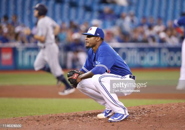 Edwin Jackson of the Toronto Blue Jays reacts after giving up a grand slam home run in the fourth inning during MLB game action to Austin Hedges of...