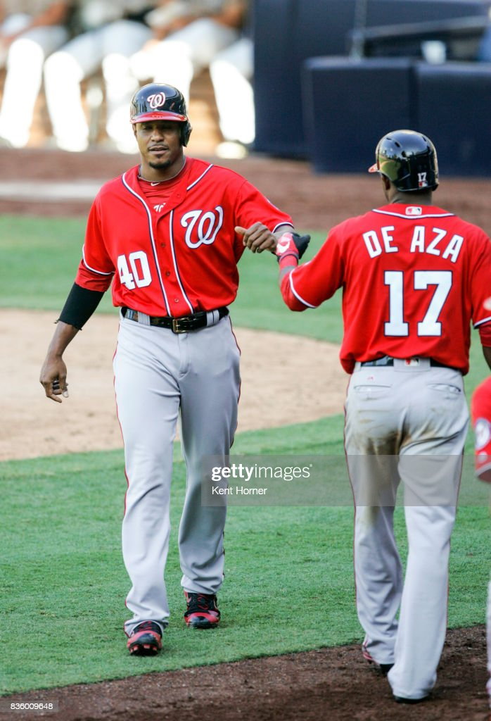 Edwin Jackson #40 of the Washington Nationals is congratulated after scoring a run in the eighth inning by teammate Alejandro De Aza #17 against the San Diego Padres at PETCO Park on August 20, 2017 in San Diego, California.