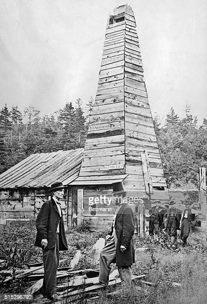 Edwin L Drake in front of the first oil well in the US which he drilled To the left is Peter Wilson