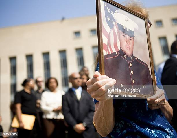Edwin Marian Johnston hold up a photo of her son US Marine CPL Edward Johnston who died in the bombing of his Lebanon barracks in 1983 outside...