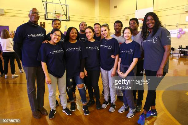 Edwin Moses Academy Member and Chairman Laureus Sport for Good USA and Benita Fitzgerald Mosley CEO Laureus Sport for Good USA pose for a photo with...