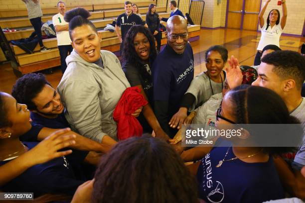 Edwin Moses Academy Member and Chairman Laureus Sport for Good USA and Benita Fitzgerald Mosley CEO Laureus Sport for Good USA particapate with...