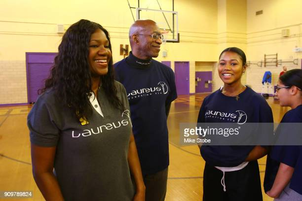 Edwin Moses Academy Member and Chairman Laureus Sport for Good USA and Benita Fitzgerald Mosley CEO Laureus Sport for Good USA laughs with students...
