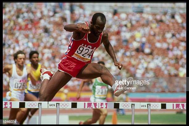 Edwin Moses of the USA clears a hurdle on his way to the gold medal in the 400m hurdles during the 1984 Summer Olympics at the Los Angeles Memorial...