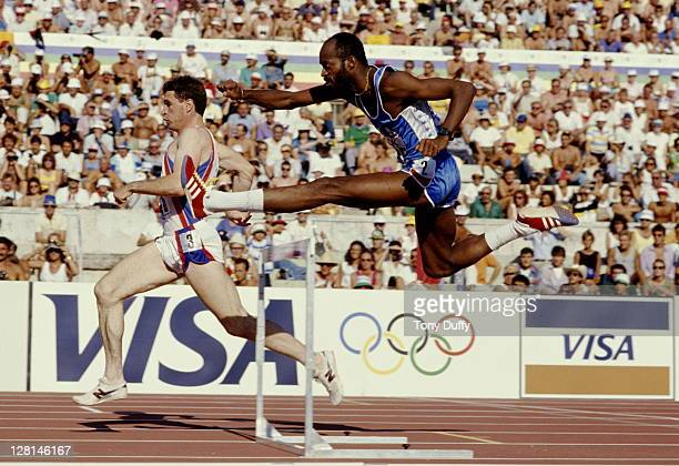 Edwin Moses of the United States clears the hurdle ahead of Martin Gillingham of Great Britain during the heats for the Men's 400 metres hurdles...