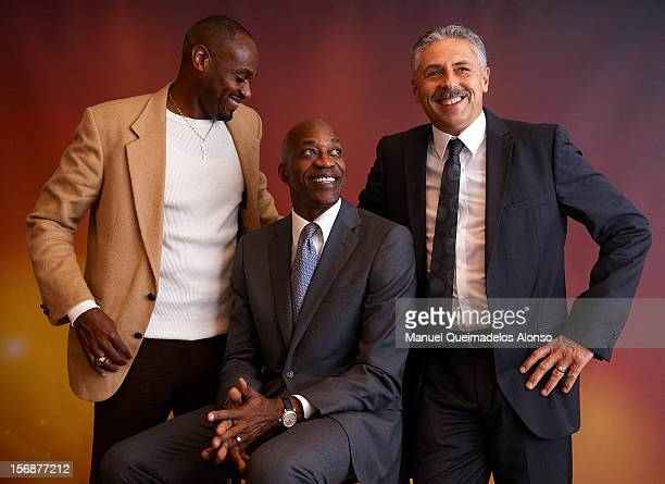 Edwin Moses of the United States Kevin Young of the United States and Harald Schmid of Germany pose during the the preview day of the IAAF Athlete of...