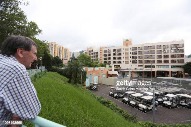 Edwin Rainbow a Discovery Bay resident who has lived there for 17 years looks at the Discovery Bay Plaza which will be redeveloped under Hong Kong...