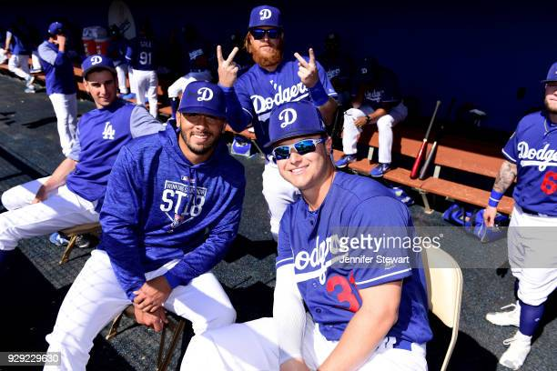 Edwin Rios and Joc Pederson of the Los Angeles Dodgers pose for a photo as Justin Turner photobombs in the background before the spring training game...
