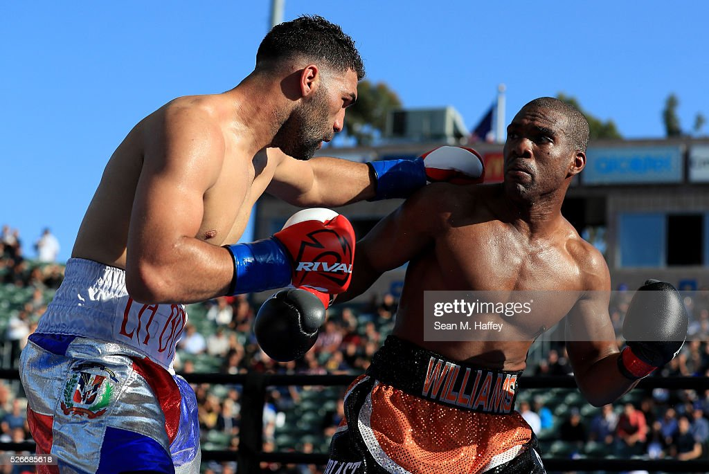 Edwin Rodriguez (L) punches Thomas Williams Jr. during a light heavyweight fight at StubHub Center on April 30, 2016 in Carson, California.