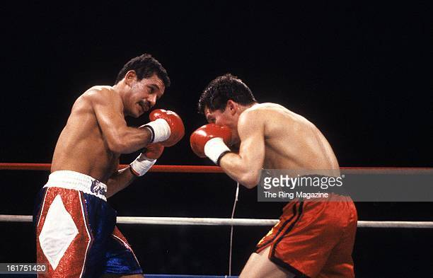 Edwin Rosario looks to land a punch to Julio Cesar Chavez during the fight at Hilton Hotel in Las Vegas Nevada Julio Cesar Chavez won the WBA World...