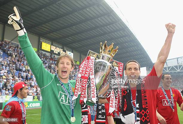 Edwin van der Sar and Rio Ferdinand of Manchester United celebrates with the Premier League trophy on the pitch after the Barclays FA Premier League...