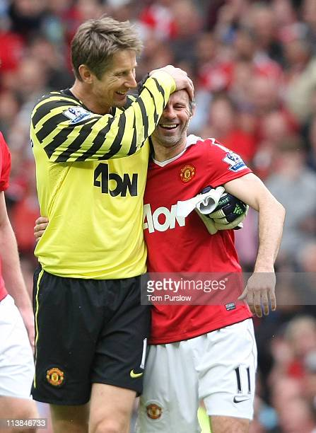 Edwin van der Sar and Ryan Giggs of Manchester United celebrate at final whistle of the Barclays Premier League match between Manchester United and...