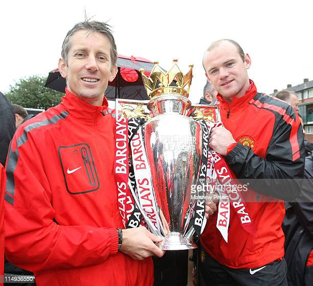 Edwin van der Sar and Wayne Rooney of Manchester United pose with the Barclays Premier League trophy during the Manchester United Premier League...